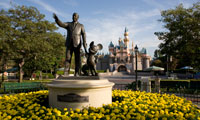 The bronze statue of Walt Disney and Mickey Mouse in the center of Walt Disney World