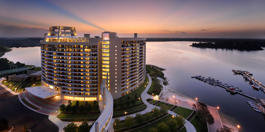 The sun setting behind Bay Lake Tower at Disney's Contemporary Resort along beautiful Bay Lake